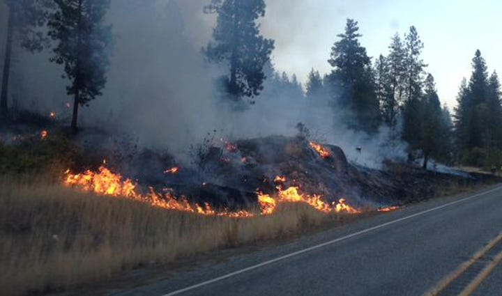 North Star Fire burning right to Hwy 155 near Nespelem