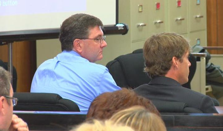 Kevin Waggoner (left in the blue shirt) in court.