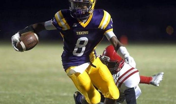 Thibodaux's Amik Robertson (8) slips the tackle of