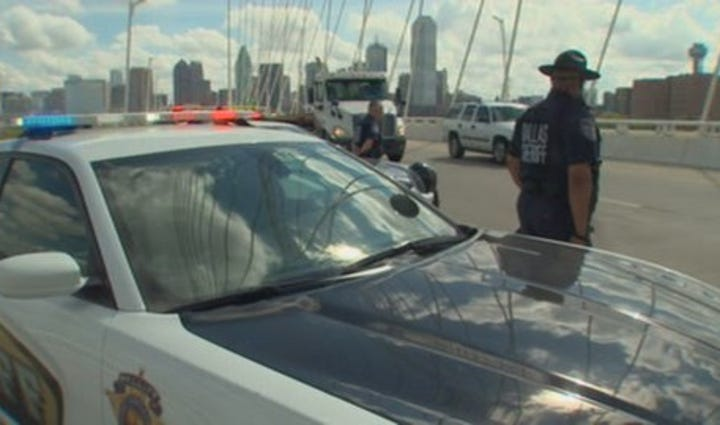 Officers line Margaret Hunt Hill Bridge in honor of