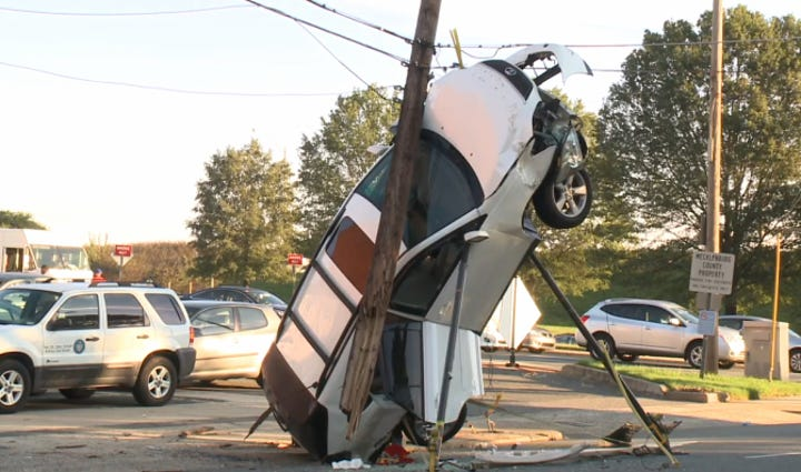 An SUV became pinned against a power pole in uptown