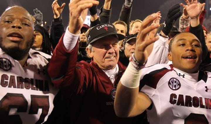 Steve Spurrier with players