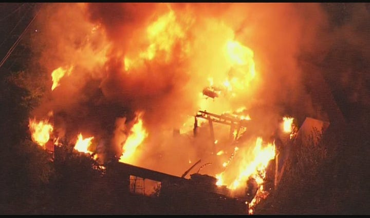 The structure was fully engulfed as crews battled the