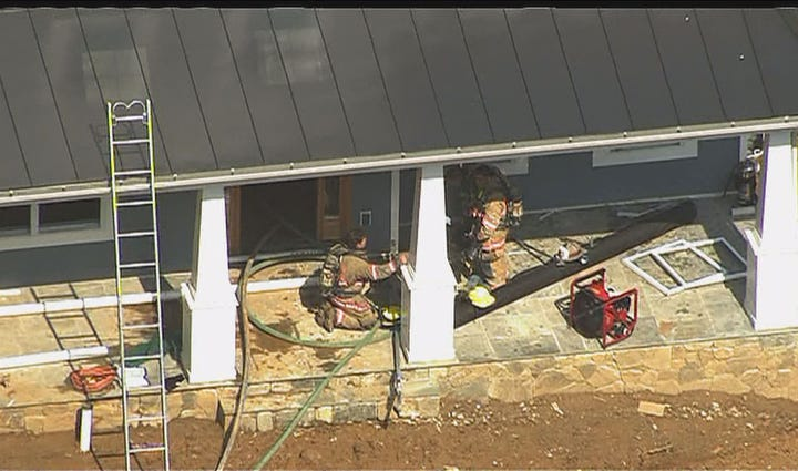 A worker was burned in a Bethesda house fire Tuesday