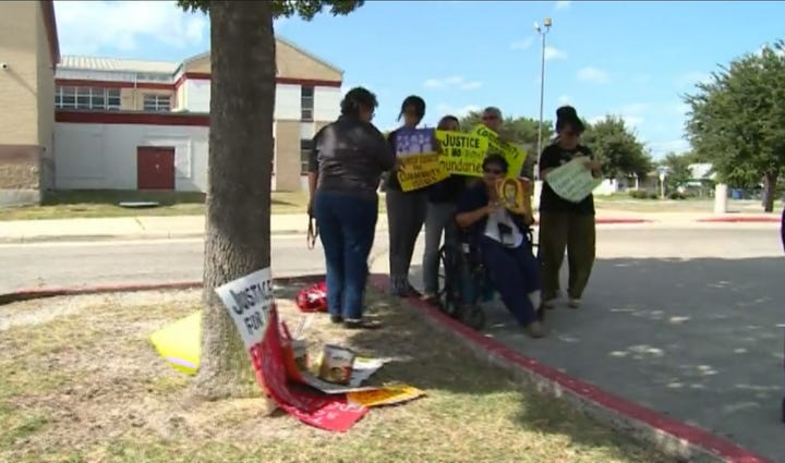Protesters at Edgewood ISD meeting