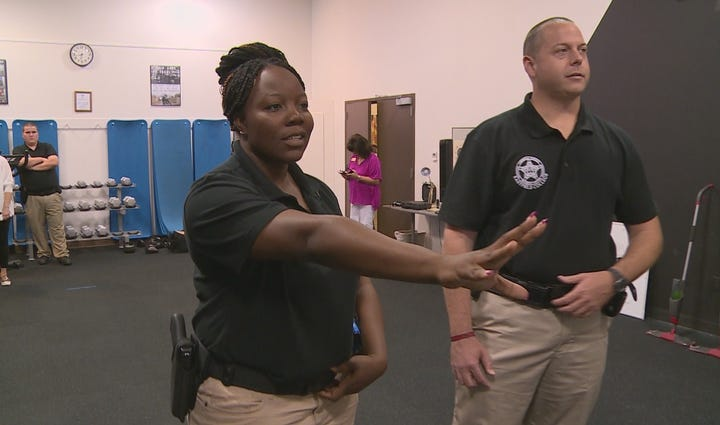 Officers go through a use-of-force simulator at Eastfield