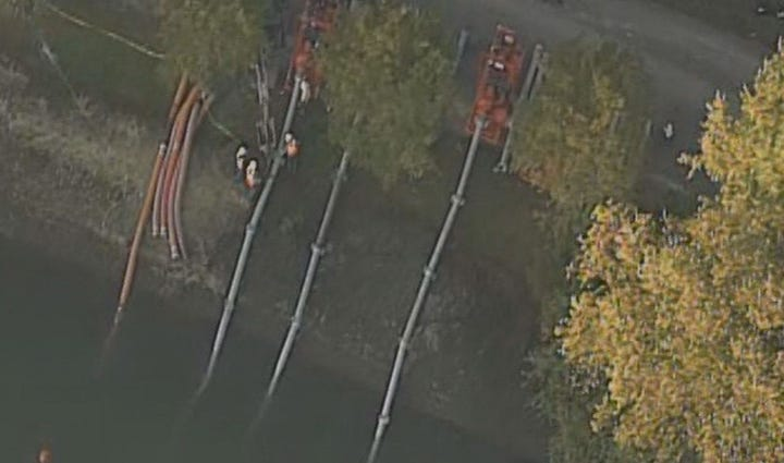 An aerial view of crews working to ease pressure on