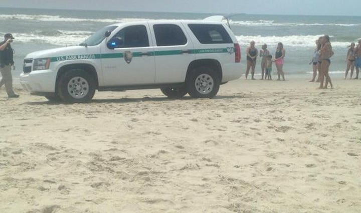 Emergency crews on the scene of a shark attack along