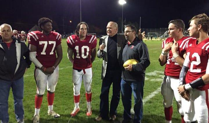 Jerry Kramer presents Golden Football to Sandpoint