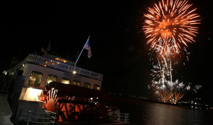 Fireworks are set off over the banks of the Mississippi