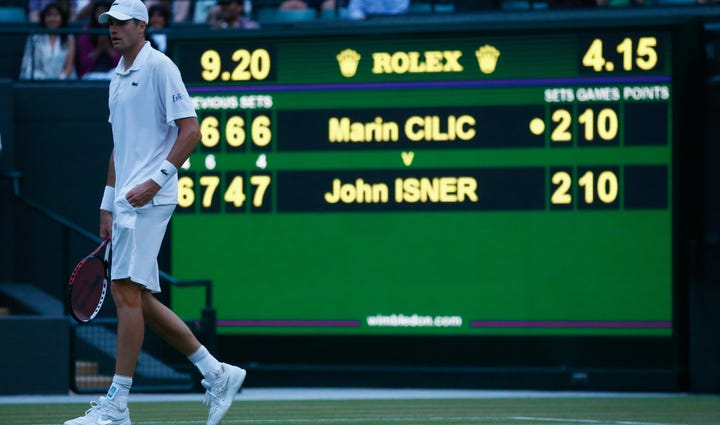 John Isner of the United States leaves the court after