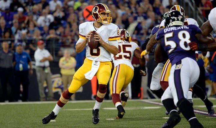 Washington Redskins quarterback Kirk Cousins (8) drops