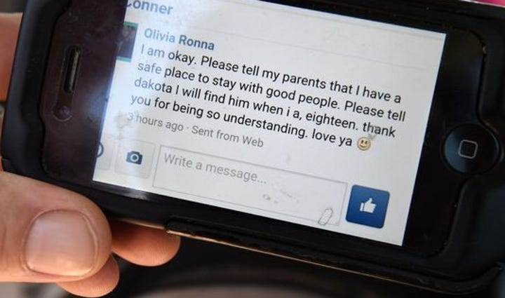 Jason Glaze shows a Facebook message that his missing