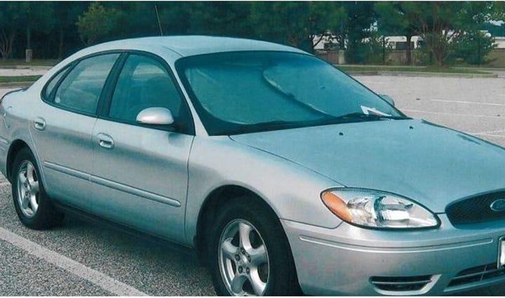 An early 2000s powder blue/grey Taurus was the car