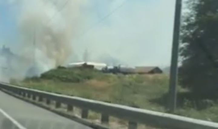 A fire burns along SR 525 on Whidbey Island, Wash,