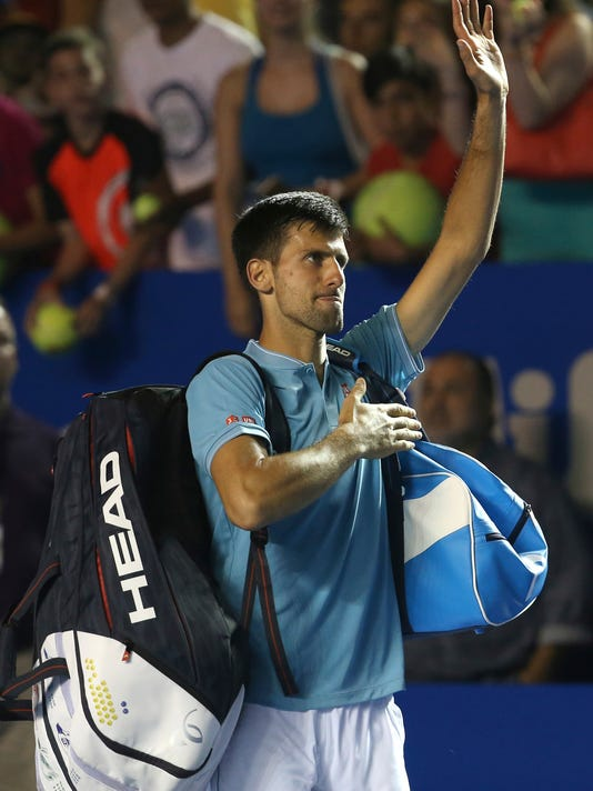 Serbia's Novak Djokovic greets the crowd as he leaves the court after loosing against Australia's Nick Kyrgios during a quarterfinal match of the Mexican Tennis Open in Acapulco, Mexico, Thursday March 2, 2017. (AP Photo/Enric Marti)