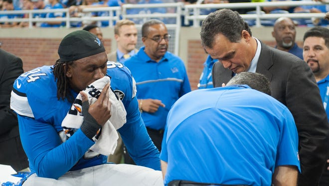 Sep 18, 2016; Detroit, MI, USA; Lions defensive end Ziggy Ansah is looked over by medical staff during the first quarter against the Tennessee Titans at Ford Field.