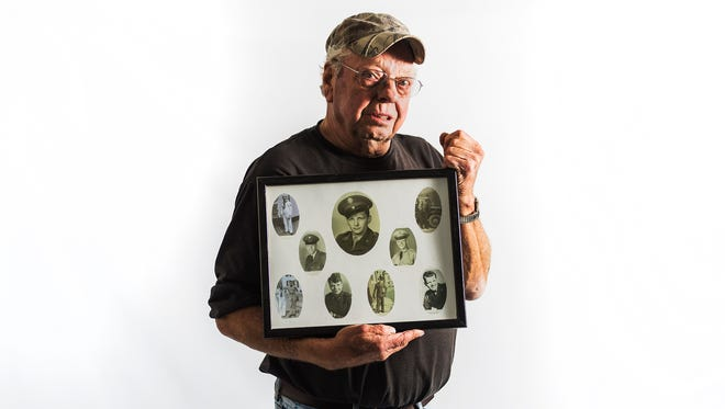 """John Wherley, 73, a U.S Army veteran who lives in Glenville, poses with a portrait of  eight of his siblings who were veterans of the Armed Forces, many serving during World War II. Four of Wherley's veteran siblings are still alive and four have since passed on. """"It's hard not being able to celebrate with them anymore,"""" Wherley said. Two of Wherley's oldest brothers served in World War II."""