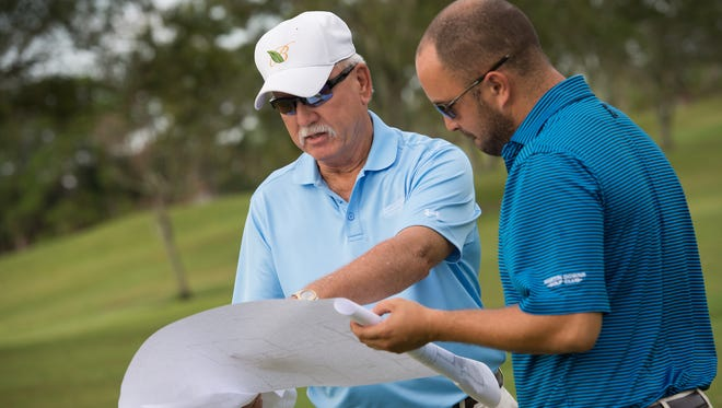 Brian Wenrick, left, managing partner at Martin Downs Golf Club, meets with golf pro Kevin Nutt at Martin Downs Golf Club in Palm City. A new course is opening this fall at the club, giving Treasure Coast golfers a natural golfing experience.