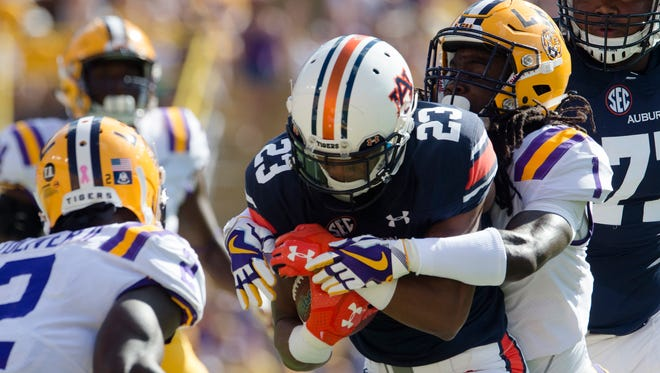 LSU defensive back Donte Jackson (1) tackles Auburn wide receiver Ryan Davis (23) during the NCAA football game between Auburn and LSU on Saturday, Oct. 14, 2017, at Tiger Stadium in Baton Rouge, La.