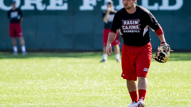 """UL second baseman Brenn Conrad (13) participates in a baseball team practice Wednesday at M.L. """"Tigue"""" Moore Field."""