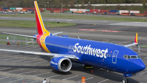 A Southwest Boeing 737 MAX 8 rests in the parking lot