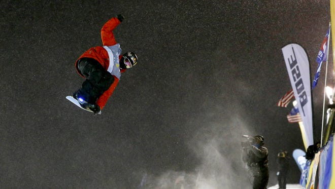 Greg Bretz of the United States flies in the sky with his snowboard during the men's U.S. Grand Prix, FIS World Cup-Halfpipe Finals at Copper Mountain in Colorado on Dec. 21.
