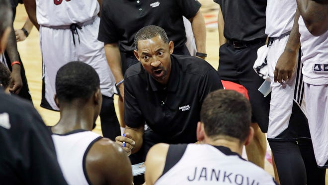 Miami Heat assistant coach Juwan Howard talks to players during a summer league game against the New Orleans Pelicans on Wednesday, July 13, 2016, in Las Vegas.