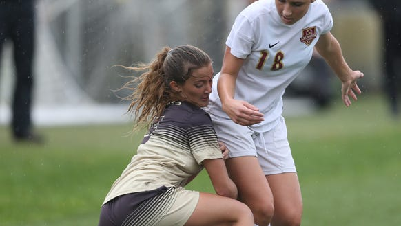 Arlington's Kelly Coster (18) and Clarkstown South's