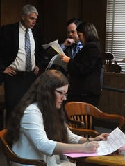 Sara Anne Woody sits in the 30th District Court as