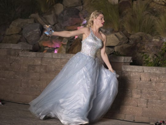 """Emma Rigby runs from the ball at midnight in """"A Cinderella Christmas,"""" now on DVD."""