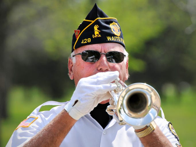 Dennis Schiffler, Waite Park Legion Post 428, plays Taps at the end of the Memorial Day ceremony at the St. Cloud VA Health System Monday.