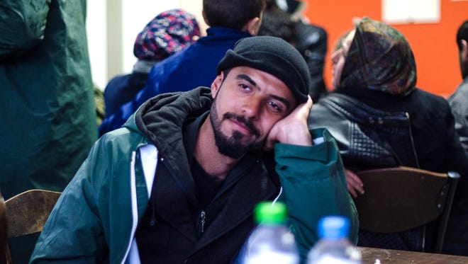 Ali Mohammed Al-Zobady from Diyala, Iraq, sits at a cafe used by refugees to get a hot meal and connect to the free Internet in Idomeni, Greece.