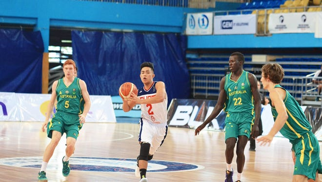 Guam's Nathaniel Kyle Arapoc brings the ball down the court against Australia's defense at the 2016 FIBA U18 Oceania Championship for Men in Suva, Fiji.