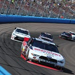 NASCAR Xfinity series driver Joey Logano leads a group of cars Saturday during the Axalta Faster Tougher Brighter 200 at Phoenix International Raceway.