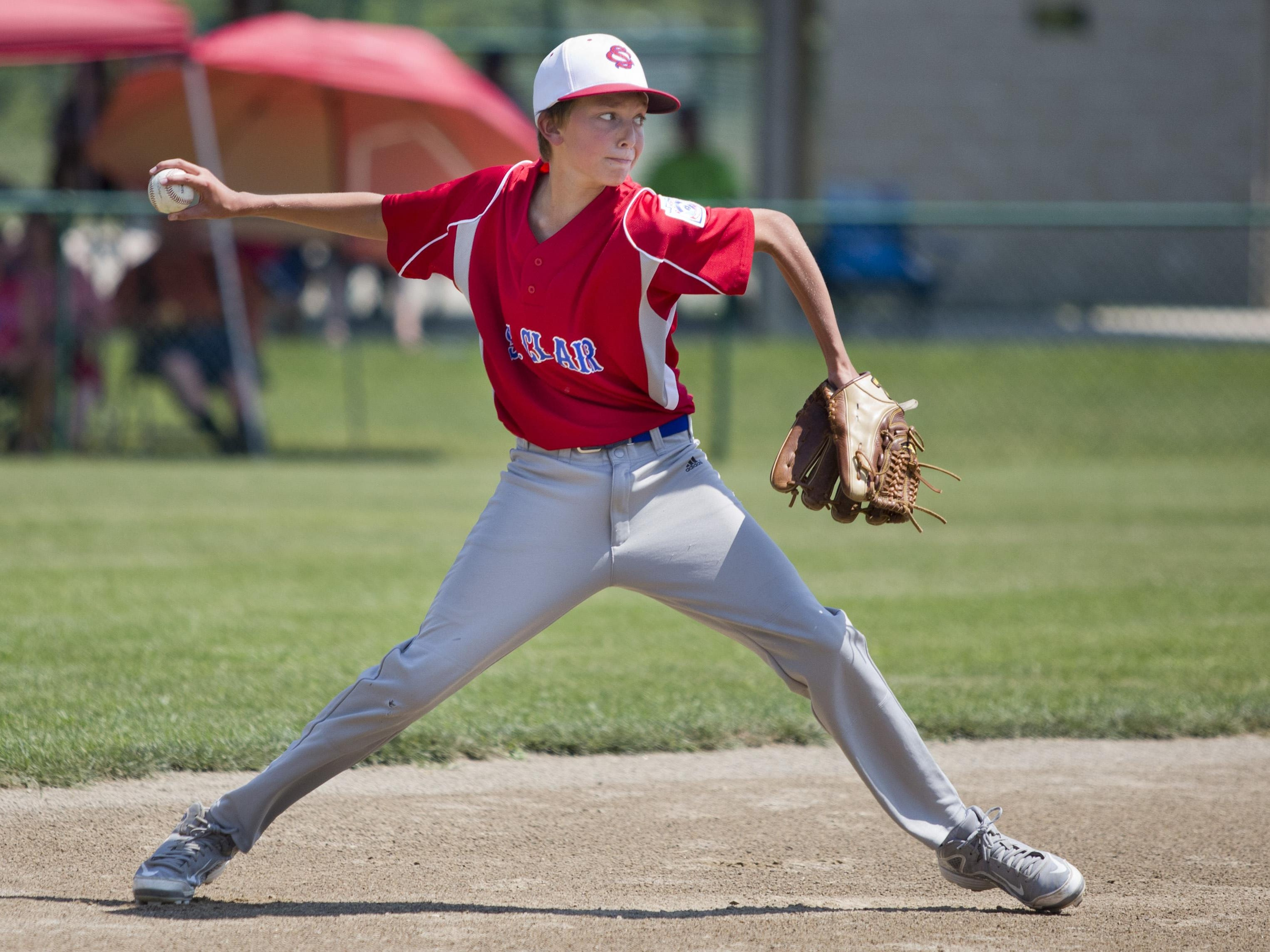 Eli Lohr throws the ball to first for an out during a 10-and-under state semifinal baseball game Tuesday, July 28, 2015 in St. Clair.