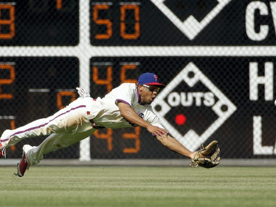 Matt Slocum — The Associated Press Philadelphia Phillies center fielder Ben Revere dives for a ball hit by the New York Mets' Curtis Granderson during the eighth inning Sunday in Philadelphia. Johnny Monell was doubled up at second base on the play. New York won 7-4.