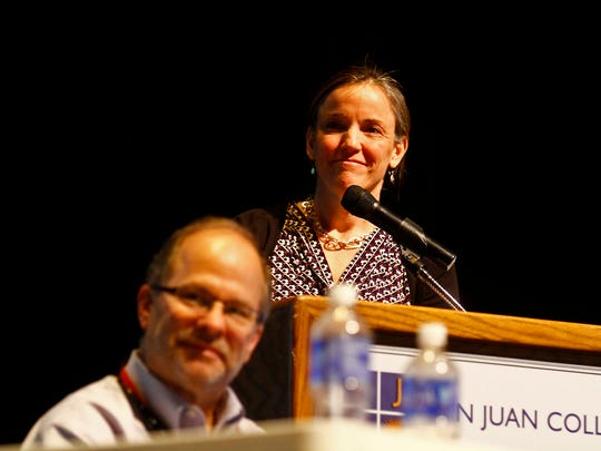 BLM Senior Adviser Tim Spisak and Deputy Assistant Secretary for Land and Minerals Management Amanda Leiter listen Tuesday during a public meeting at the Henderson Fine Arts Center at San Juan College in Farmington.