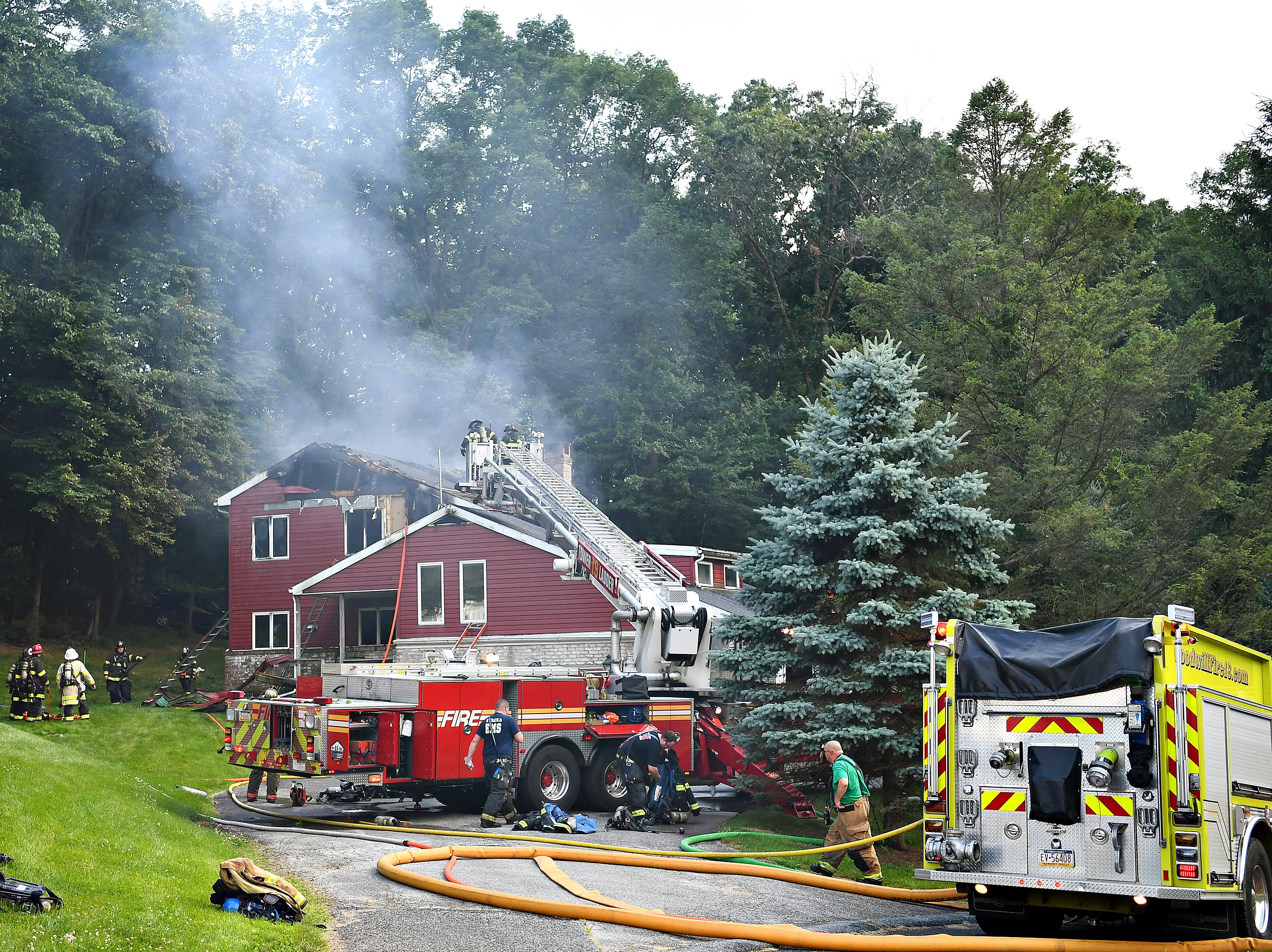 Firefighters At The Scene Of A Fatal House Fire At