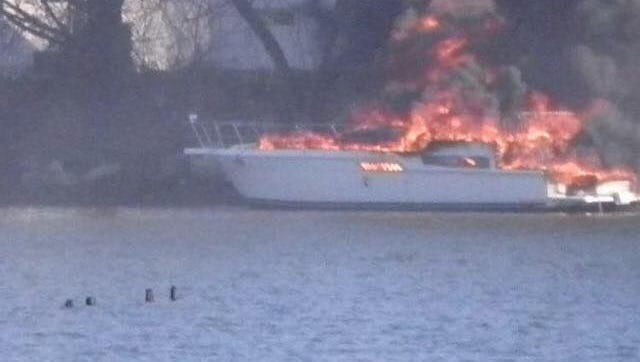 A boat burns on the water off New Rochelle marina, Jan. 1, 2017.