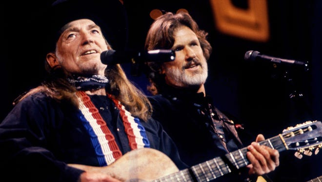 "Willie Nelson, left, and Kris Kristofferson are performing ""Waltz Across Texas"" during the Texas tribute segment of the CBS two-hour ""A Country Music Celebration: The 30th Anniversary of the Country Music Association"" special at the Grand Ole Opry House Jan. 7, 1988."