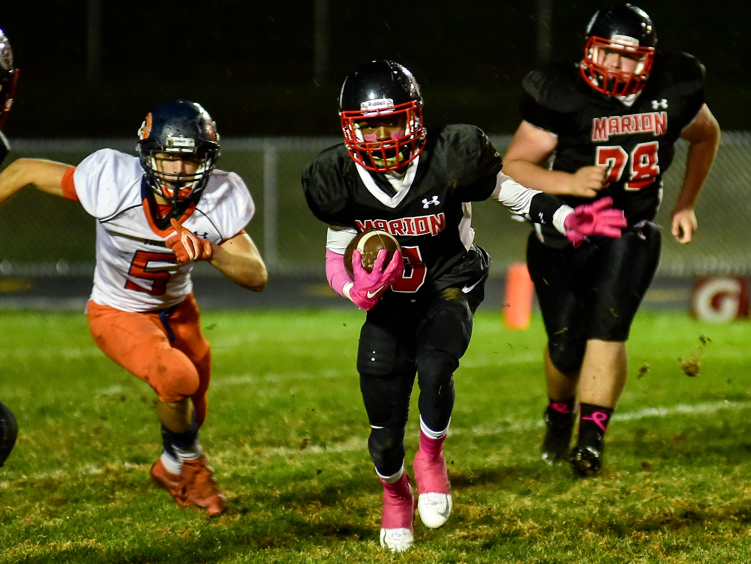 Marion Harding's TJ Jefferson looks to avoid Galion defense during the Marion Harding vs Galion game on Friday.