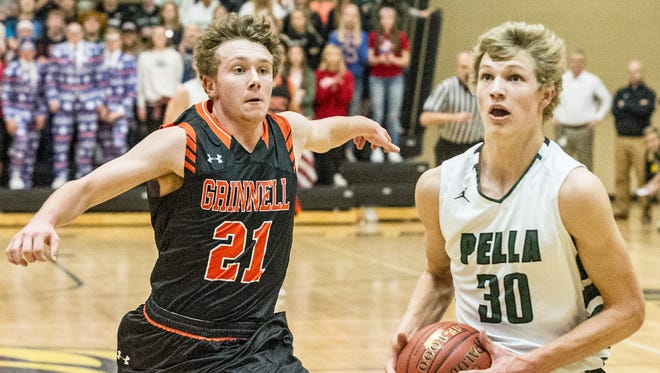 Pella's Donovan Holterhaus take the opportunity for a runaway fast break as Grinnell's Ethan Mitchell make a chase out of it. Pella boys basketball team defeated the Grinnell, boys, 55-53 in substate play at Southeast Polk Monday.