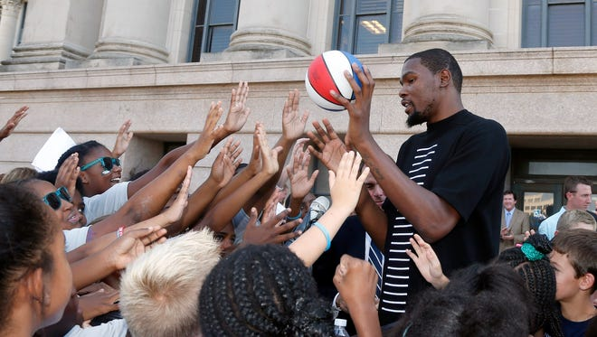 Kevin Durant greets students at a child obesity event in Oklahoma City.