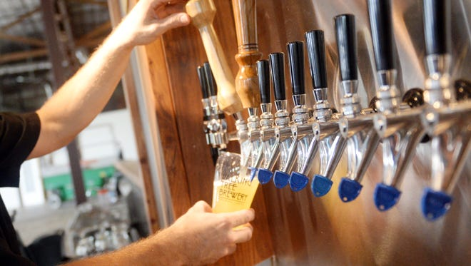 Alan Dritenbas, co-founder of Walking Tree Brewery, pours a glass of Single Girlfriend. The brewery is partnering with The Wave to host a beer dinner Oct. 27.