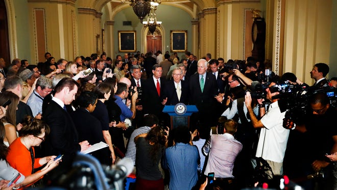 """Senate Majority Leader Mitch McConnell of Ky., center, joined by, from left, Sen. Cory Gardner, R-Colo., Sen. John Barrasso, R-Wyo., Sen. Roy Blunt, R-Mo., and Senate Majority Whip John Cornyn of Texas, speaks during a news conference on Capitol Hill in Washington, Tuesday, July 18, 2017. President Donald Trump blasted congressional Democrats and """"a few Republicans"""" over the collapse of the GOP effort to rewrite the Obama health care law.  (AP Photo/Carolyn Kaster)"""