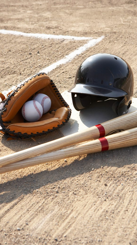 Baseball glove, balls, bats and baseball helmet at