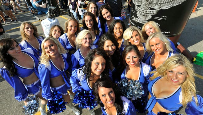 The Detroit Pride cheerleaders gather for photos outside Ford Field in 2011.