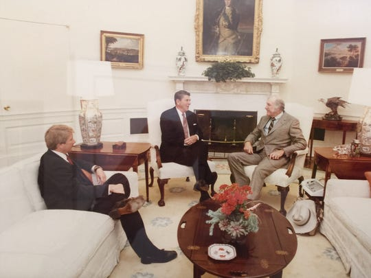 Grits Gresham interviews President Ronald Reagan in the Oval Office in 1983 while Reagan's press secretary, Larry Speakes, looks on.