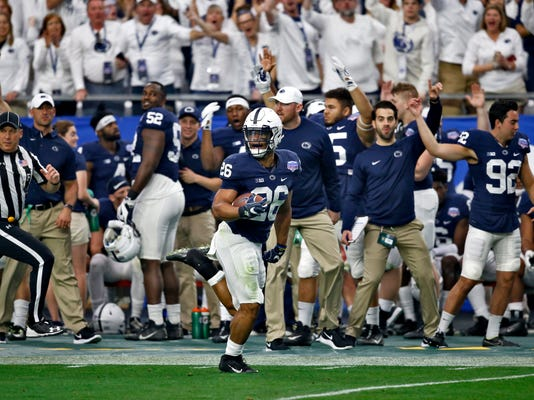 Penn State running back Saquon Barkley (26) breaks free for a 92-yard touchdown run during the first half of the Fiesta Bowl NCAA college football game against Washington, Saturday, Dec. 30, 2017, in Glendale, Ariz. (AP Photo/Ross D. Franklin)
